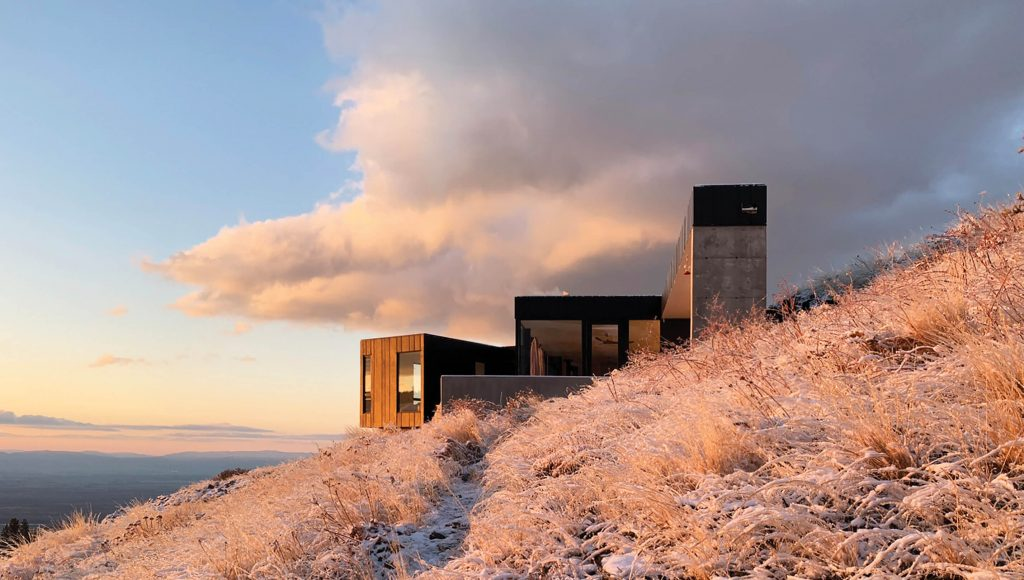 """The architect Steve Bull describes his family escape as """"just a rustic cabin,"""" but even though it's a mile and a half from the nearest power source and snow-plowed roads, the resulting structure includes refined design details missing from many rustic buildings. The windows and doors are by Stile, and the siding is by James Hardie."""